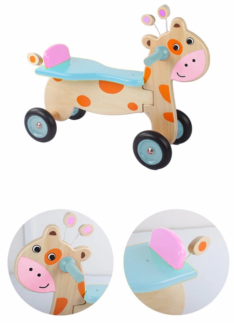 Jirafita de montar juguete para niñas